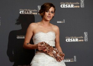"Actress Kristen Stewart poses with her trophy during a photocall after winning the Best Supporting Actress Award for her role in the film ""Sils Maria"" during the 40th Cesar Awards ceremony in Paris"